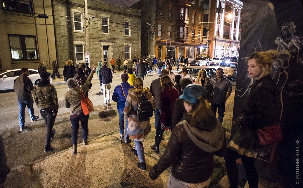 AE Bridger leads processional from the LSPU Hall to The Ship Pub on Saturday Night.
